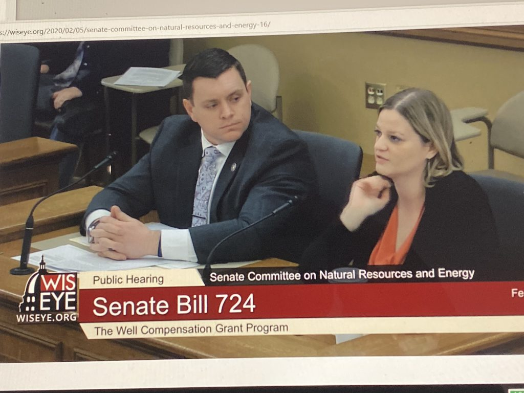 Photo: Rep. Katrina Shankland (right), Democrat of Stevens Point, sponsor of a bill on the well compensation program, speaks Feb. 5 at Hearing of Assembly Natural Resources and Energy Committee in Madison. Sen. Patrick Testin, Republican of Stevens Point (left), is Senate sponsor of the bill.