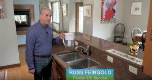 Former U.S. Senator Russ Feingold with a water pitcher